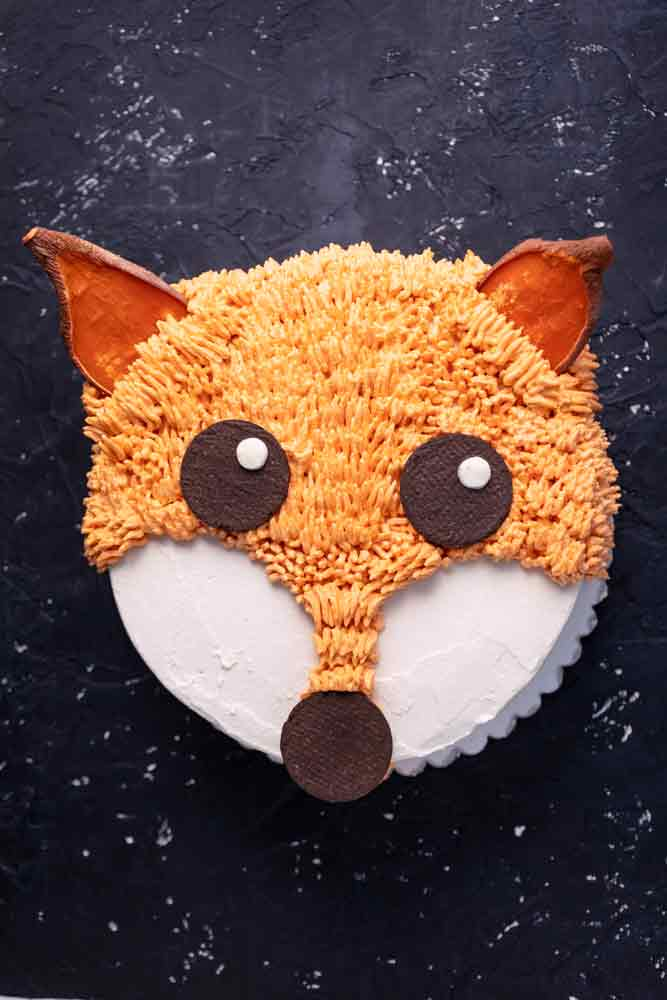 vegan carrot cake decorated to look like a fox