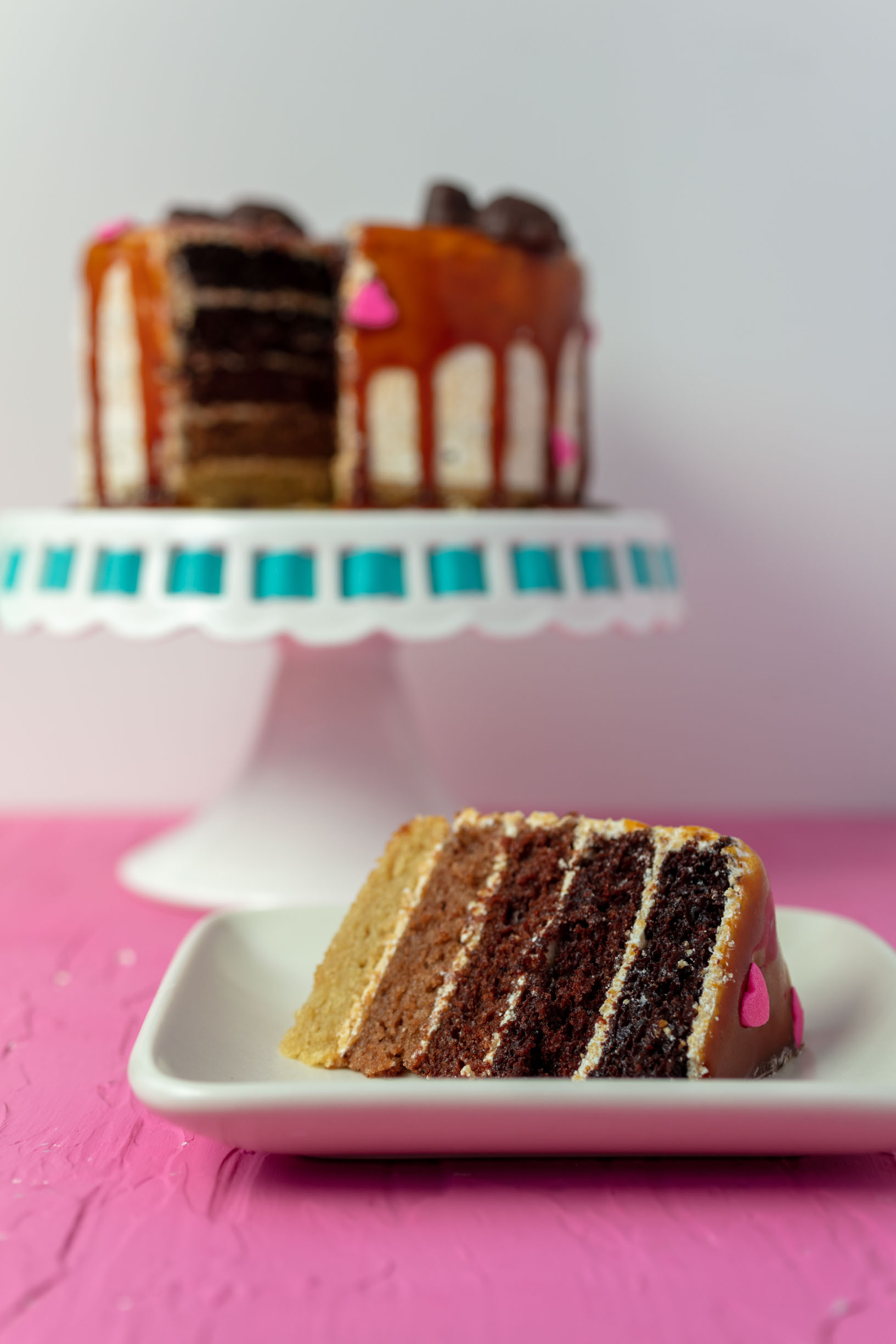 slice of vegan chocolate caramel ombré heart cake