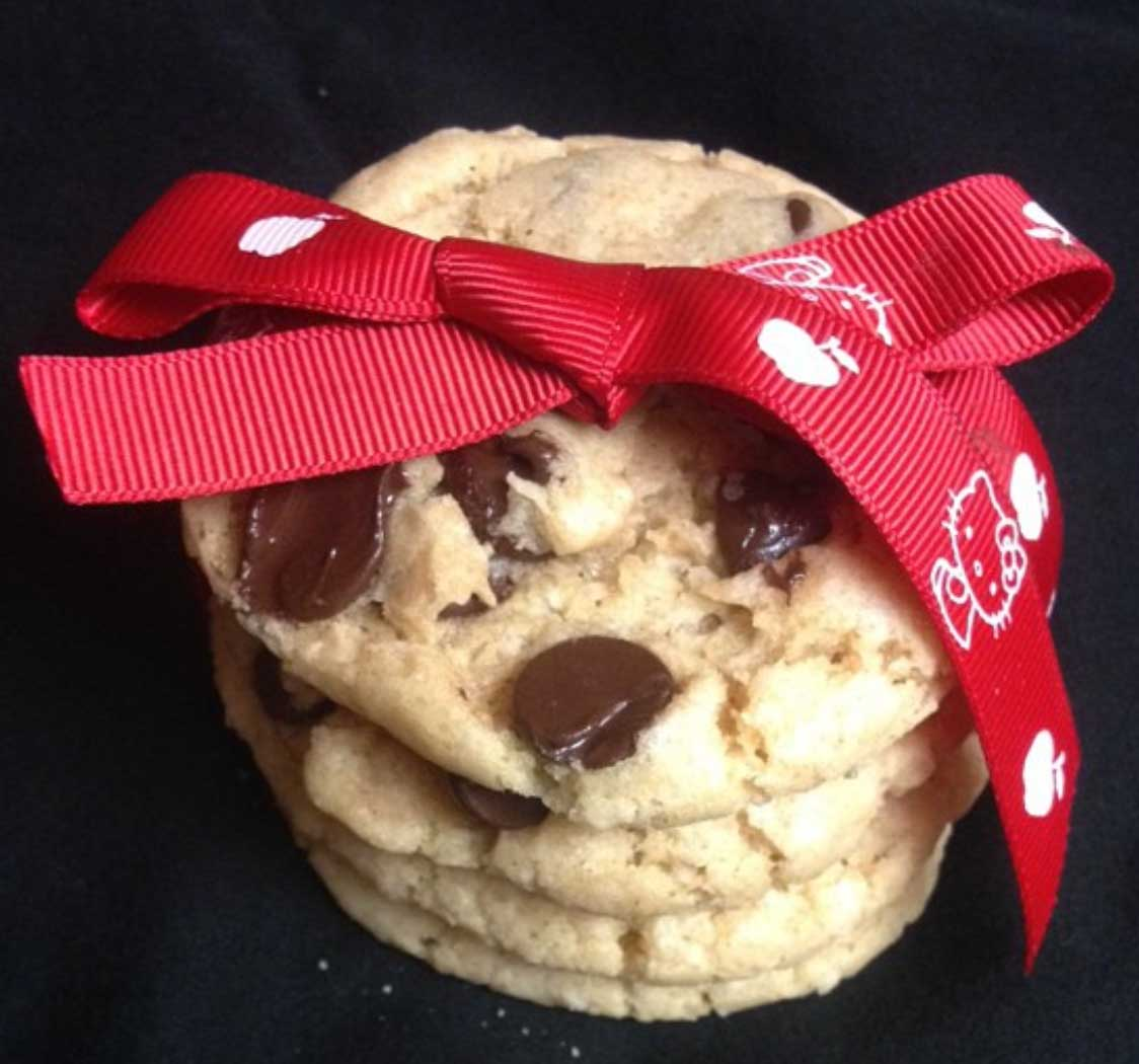 stack of vegan chocolate chip cookies tied with a bow