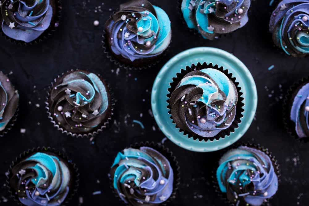 vegan chocolate cupcakes with galaxy buttercream frosting