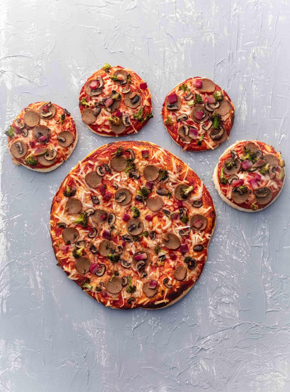 vegan pizza shaped like a giant paw print