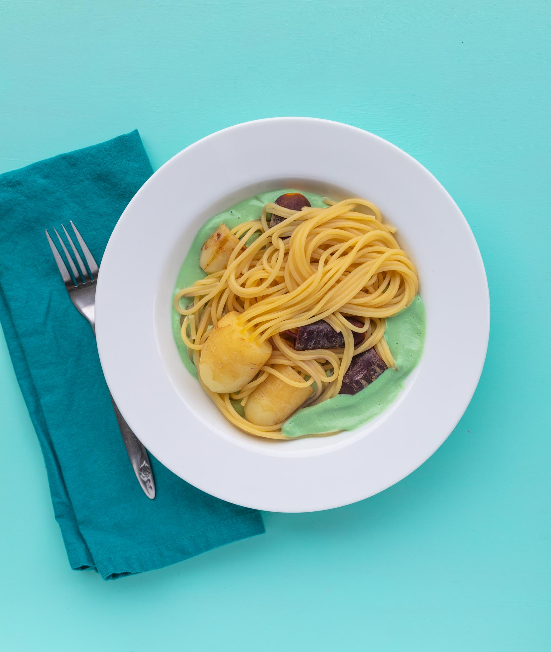 Spaghetti Carrot Squid in a sea of teal cashew cream sauce