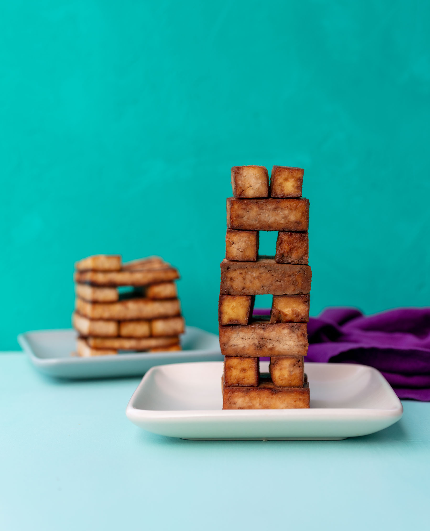 playing jenga with Vegan Teriyaki Tofu
